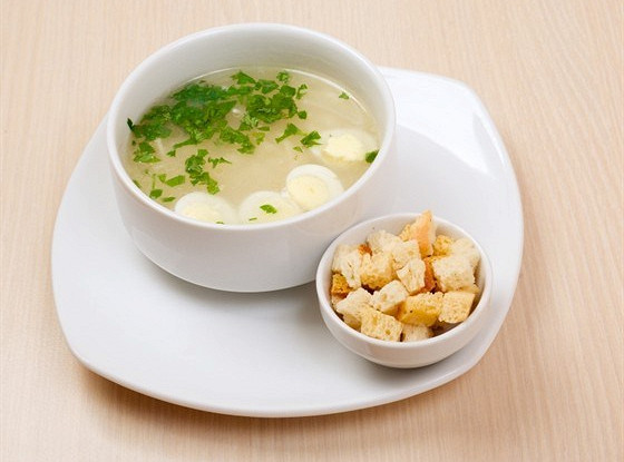 Soup with rice, egg and parsley