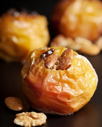 Apples baked with rice, fruits and nuts
