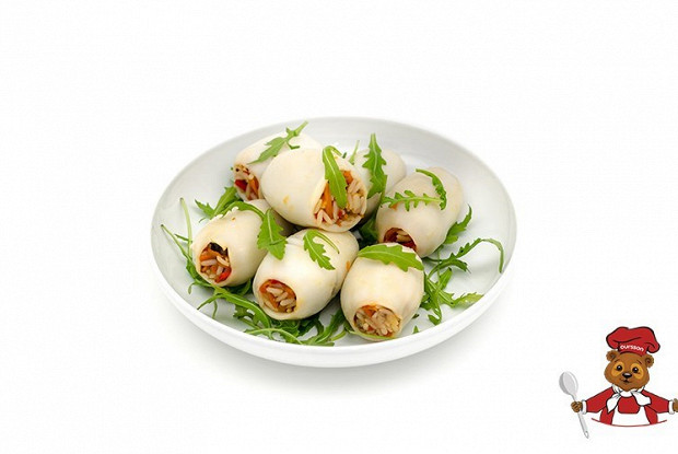 Stuffed squid with rice and vegetables