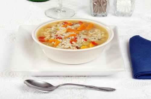 Soup with rabbit and carnaroli rice