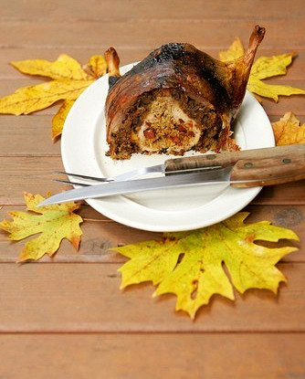Roasted duck stuffed with rice, nuts and aromatic herbs