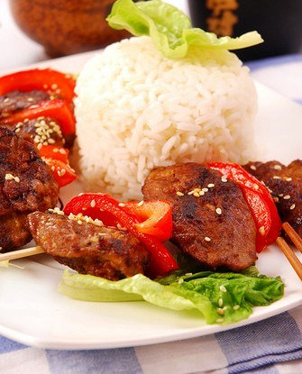 Pork kebabs with red peppers and pineapple rice