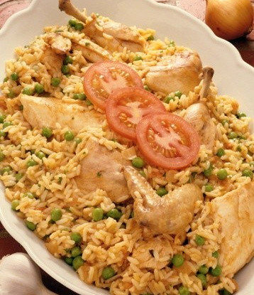 Chicken legs with saffron, rice and green peas