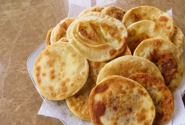 Thin pies with potatoes and meat (stuffed tortillas)