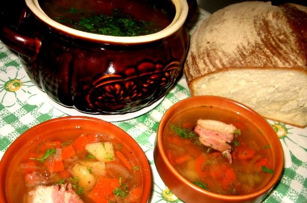 Vegetable soup with smoked brisket in a pot