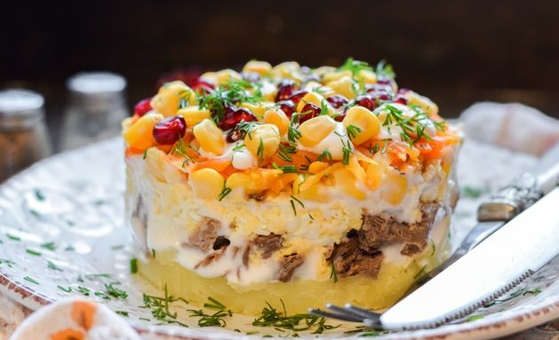 Puff salad with beef, potatoes, carrots and corn
