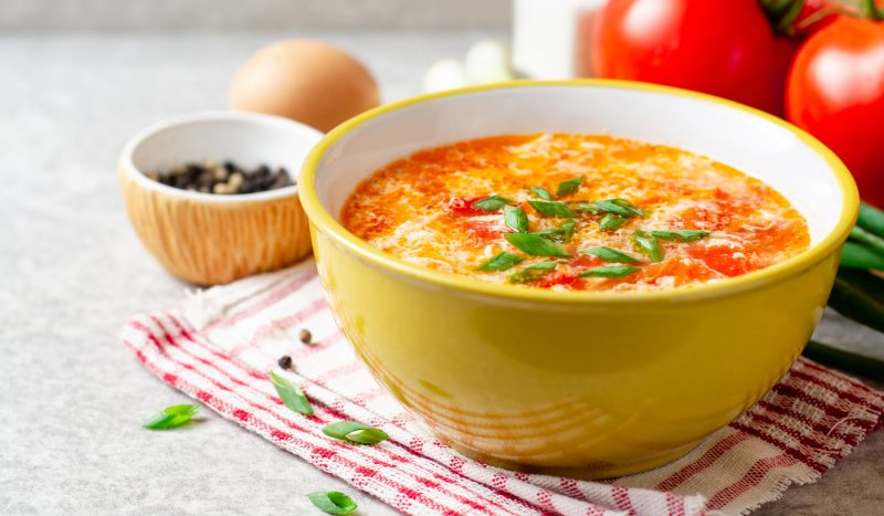 Light chicken soup with eggs and tomatoes