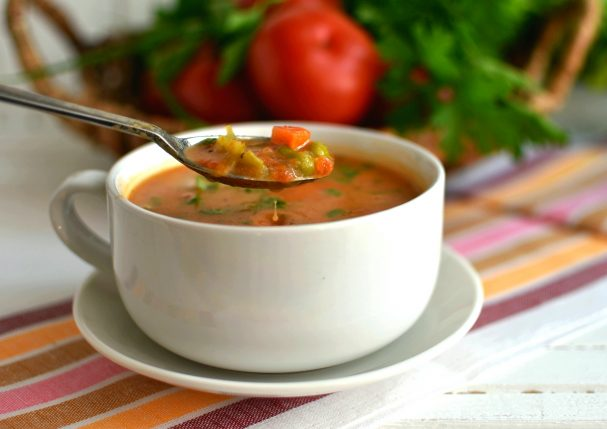 Tomato soup with vegetables and melted cheese