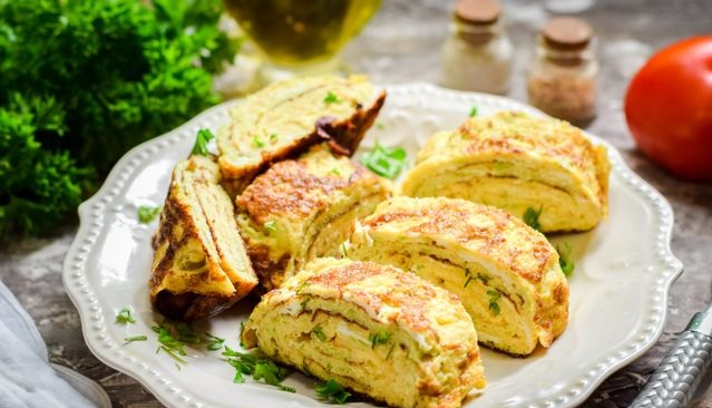 Zucchini omelette roll with cheese filling