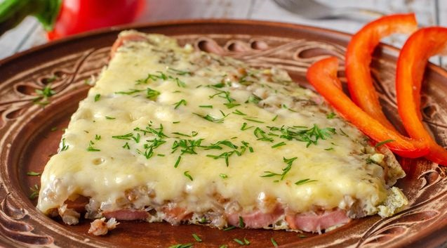 Omelet with buckwheat, sausages and cheese