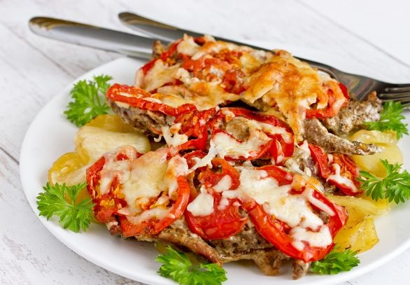 Beef chops baked with potatoes, tomatoes and cheese