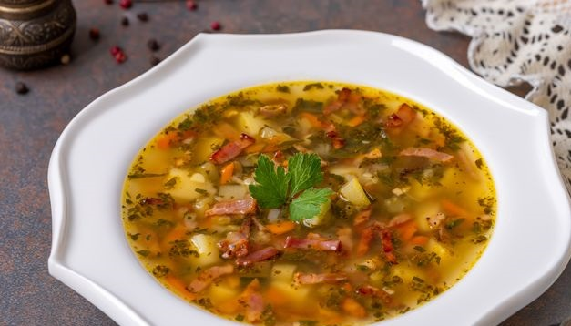 Potato soup with zucchini, celery and bacon