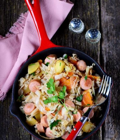 Stewed cabbage with potatoes and sausages