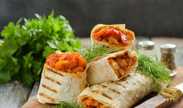 Lavash roll with potatoes, zucchini, cabbage and pepper