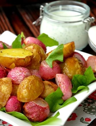 Young potatoes baked with radish, with garlic kefir-cheese sauce