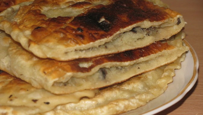 Fried pies with potatoes and mushrooms