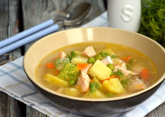 Salmon soup with green peas and potatoes